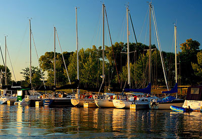line of sailboats in Suttons Bay, Michigan harbor